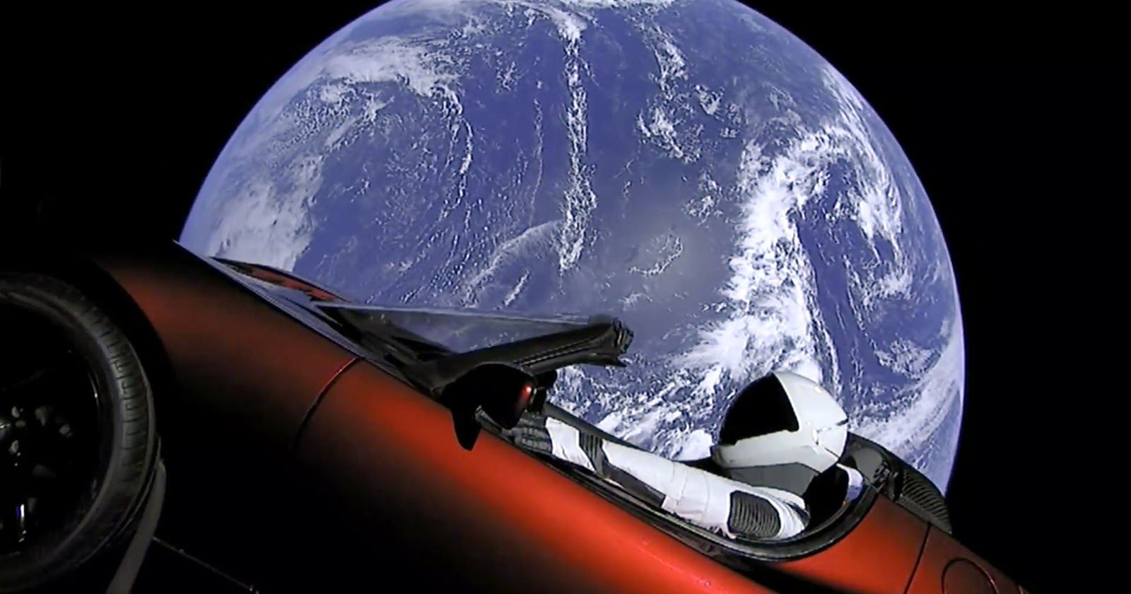 Tesla's red car in outer space, floating past Earth with Rocketman at the wheel